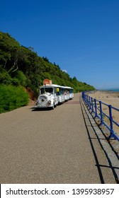 Eastbourne, Sussex, UK - August 1, 2018:  White Dotto train that runs along the seafront at Eastbourne. Trains carries people along the resort.