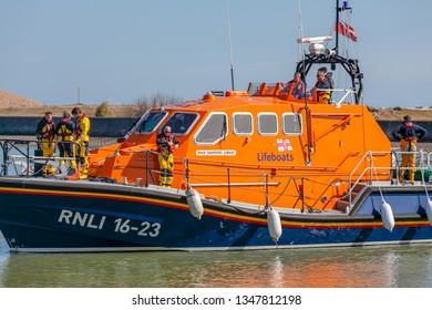 Eastbourne Sussex UK, March 24 2019: Eastbourne All weather lifeboat 16-23 returns to the harbour after the weekly training exercise