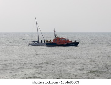 Eastbourne Sussex UK, March 31st 2019: Eastbourne all weather lifeboat 16-23 was called out at lunchtime to assist a sailing boat that had got into difficulty just outside Eastbourne Harbour.
