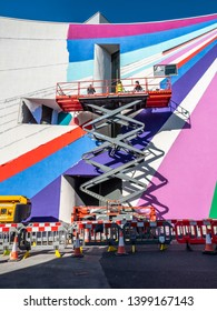 Eastbourne, UK - 14 May 2019: The German artist Lothar Götz at work transforming the exterior to the Eastbourne Towner Art Gallery into a large-scale artwork to mark the gallery's 10th anniversary.