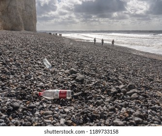EASTBOURNE, UK - 21 SEPTEMBER 2018: Chinese plastic water bottle blown onto the beach at Birling Gap near Eastbourne