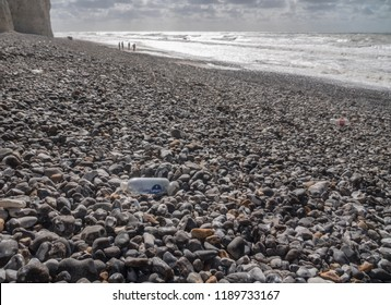 EASTBOURNE, UK - 21 SEPTEMBER 2018: Smart water bottle blown onto the beach on stormy day at Birling Gap near Eastbourne