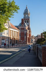 EASTBOURNE, UK - 21 SEPTEMBER 2018: Town hall and clock tower in seaside resort of Eastbourne, Sussex