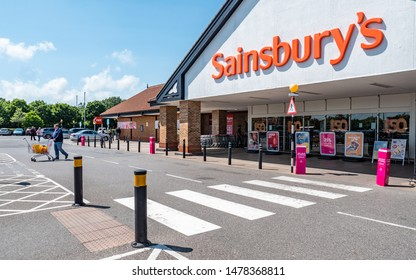 EASTBOURNE, UK - 3 JUNE 2019: Sainsbury's Supermarket. The entrance and facade to a branch of the giant UK supermarket chain, Sainsburys, on a bright sunny day in the English town of Eastbourne.