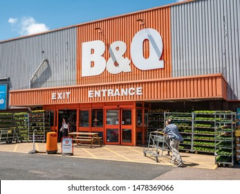 EASTBOURNE, UK - 3 JUNE 2019: B&Q DIY Superstore. Customers entering and leaving the English DIY store supermarket B&Q on a bright and sunny day in Eastbourne, East Sussex.