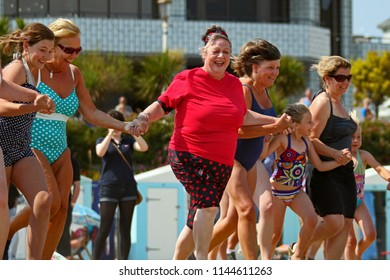 Eastbourne,East Sussex/UK 06-04-11 Comedienne Jo Brand in Eastbourne filming Jo Brand's Big Splash which was screened in 2011.Here she is preparing to run into the sea with fellow swimmers of all ages