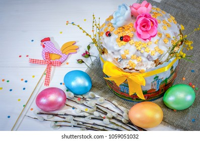 Easter background with branches of willow, Easter cake and eggs