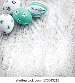 Easter background with colorful eggs on texture rustic white background