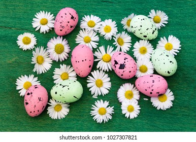 Easter background with colorful eggs and spring flowers