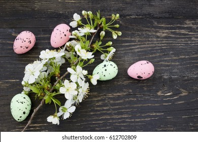Easter background with Easter eggs and cherry flowers