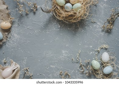 Easter background. Easter eggs with easter decoration, top view. Copy space.