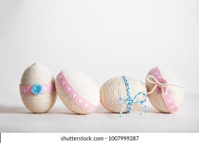 Easter background with Easter eggs, pastel colours decoration on the white background