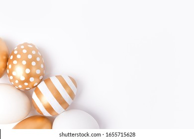 Easter background. Easter golden decorated eggs isolated on white background. Minimal easter concept. Flat Lay of Golden Easter Eggs.