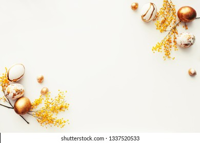 Easter background with golden eggs/top view