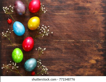 Easter background with painted eggs and festive decor