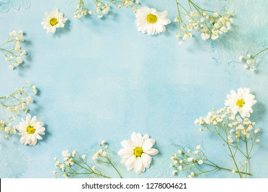 Easter background with spring flowers. Top view flat lay background with.