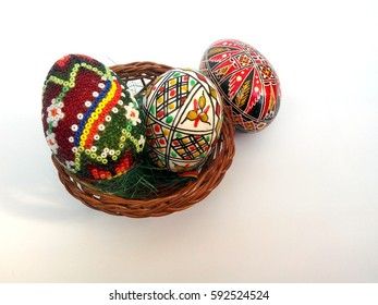 Easter background: three eggs decorated with different patterns, two painted and one beaded