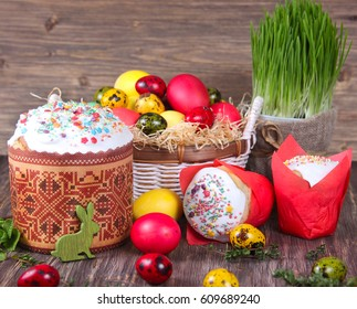 Easter background. Traditional food on the holiday table - Easter Cake  and Easter painted eggs. Easter recipe.