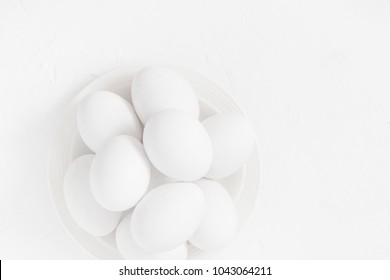 Easter background: White eggs in a bowl