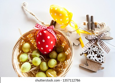 Easter background. Wooden bunny and eggs, Easter eggs in a little basket.