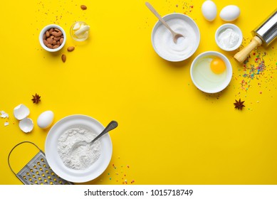Easter bakery concept, various products for home baking, such as sugar, butter, yogurt and eggs and flour, view from above arrangement, blank space for a text