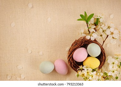 Easter basket with colored eggs over linen