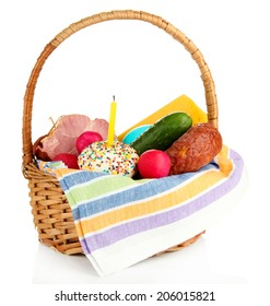 Easter basket: Conceptual photo of traditional easter food in wicker basket, isolated on white