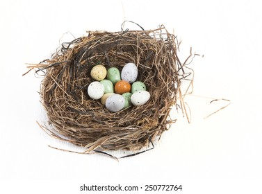 Easter basket decorated with eggs against white background