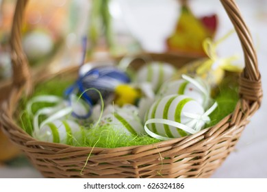 Easter basket with eggs and easter decorations on table