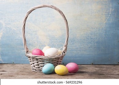 Easter. Basket with eggs on a blue background