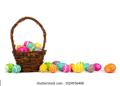 Easter basket with long border of colorful hand painted Easter Eggs over a white background