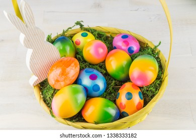 Easter basket with many colorful Easter eggs