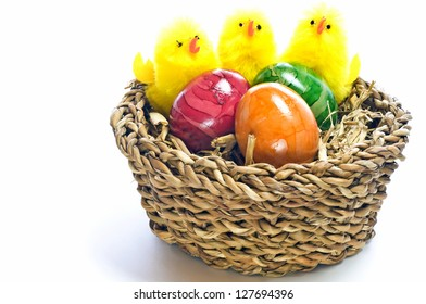 easter basket with painted eggs and biddies
