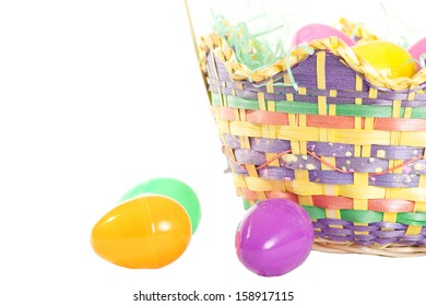 An Easter basket with plastic eggs isolated on white.