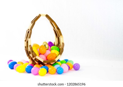 An easter basket sits filled with colorful easter eggs.