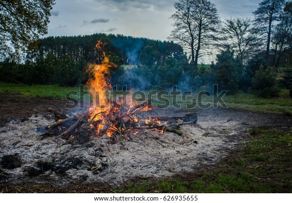 Easter bonfire in the evening in beautiful rural area in Europe