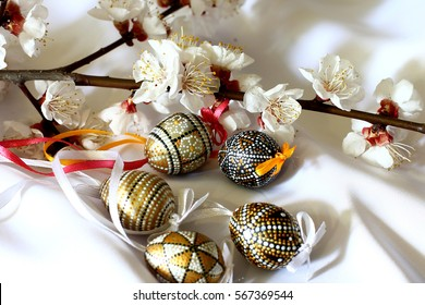 Easter bouquet of spring flowering tree and Easter eggs.