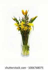 Easter bouquet, spring flowers tulips, narcissi and willow buds in a vase