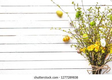 Easter branches with easter eggs, spring bouquet with daffodil and branch of birch tree