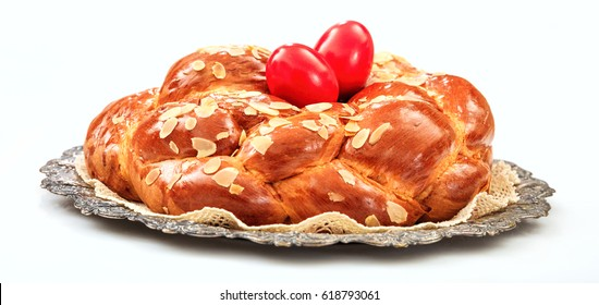 Easter bread, greek tsoureki and red easter eggs isolated on white background