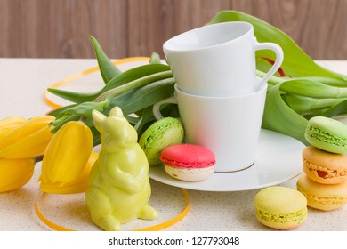 easter breakfast with coffee, rabbit, fresh tulips and macaroons