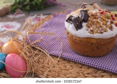 easter breakfast with coloured eggs, easter bread with dried fruits and nuts