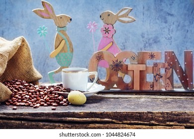 Easter breakfast with fresh coffee, Easter egg and Easter Bunny