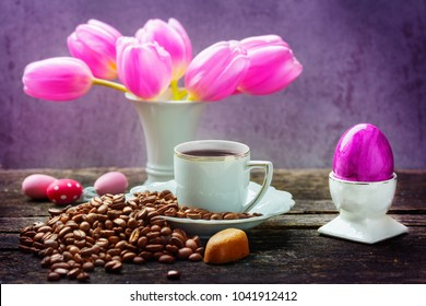 Easter breakfast, fresh coffee, easter eggs and tulips