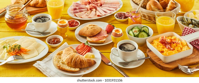 Easter breakfast panorama banner with a wholesome spread of assorted bread rolls honey and preserves