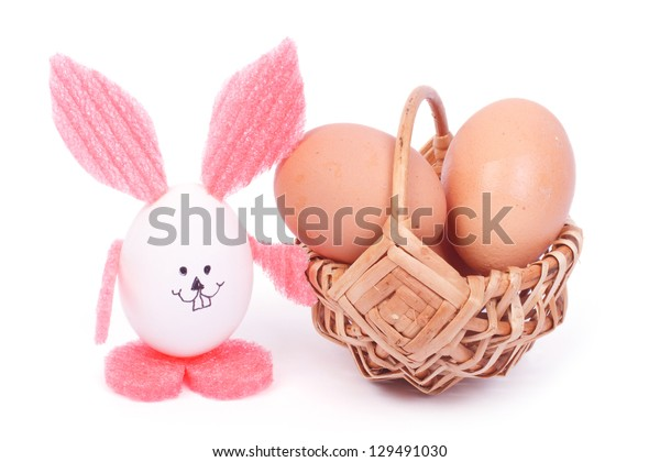 Easter Bunny and basket of chicken eggs isolated on white background