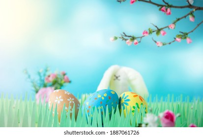 Easter bunny with decorated eggs on fresh grass outdoors. Copy space. Banner and greeting card by Easter. Selective focus - Shutterstock ID 1887061726