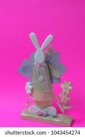 Easter bunny decoration on bright pink background