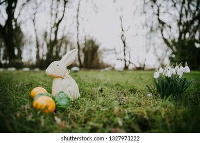 Easter bunny and eggs on a green grass.