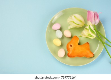 Easter bunny, Easter eggs and tulips